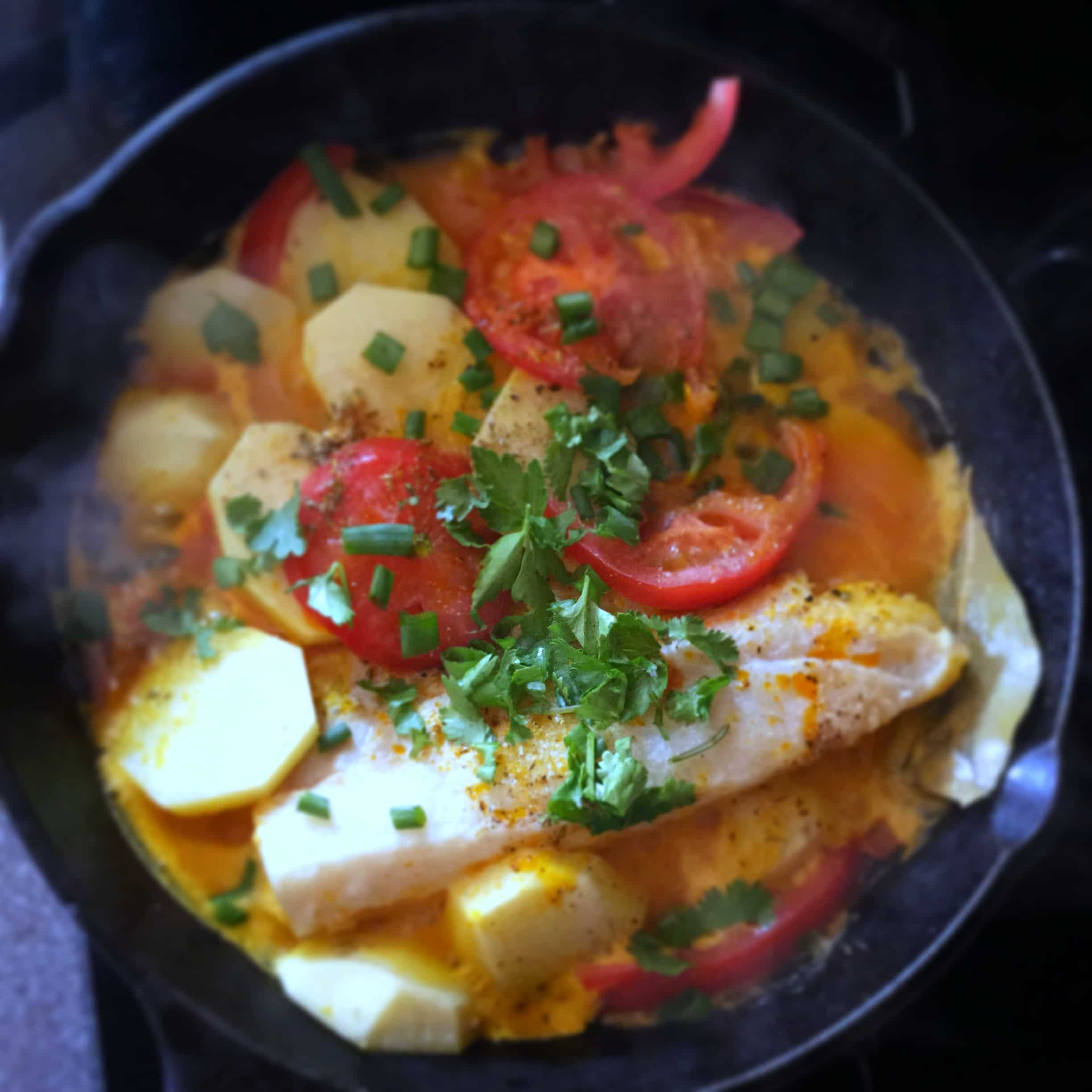 Brazilian fish stew cooked in coconut milk with tomatoes, onions ...