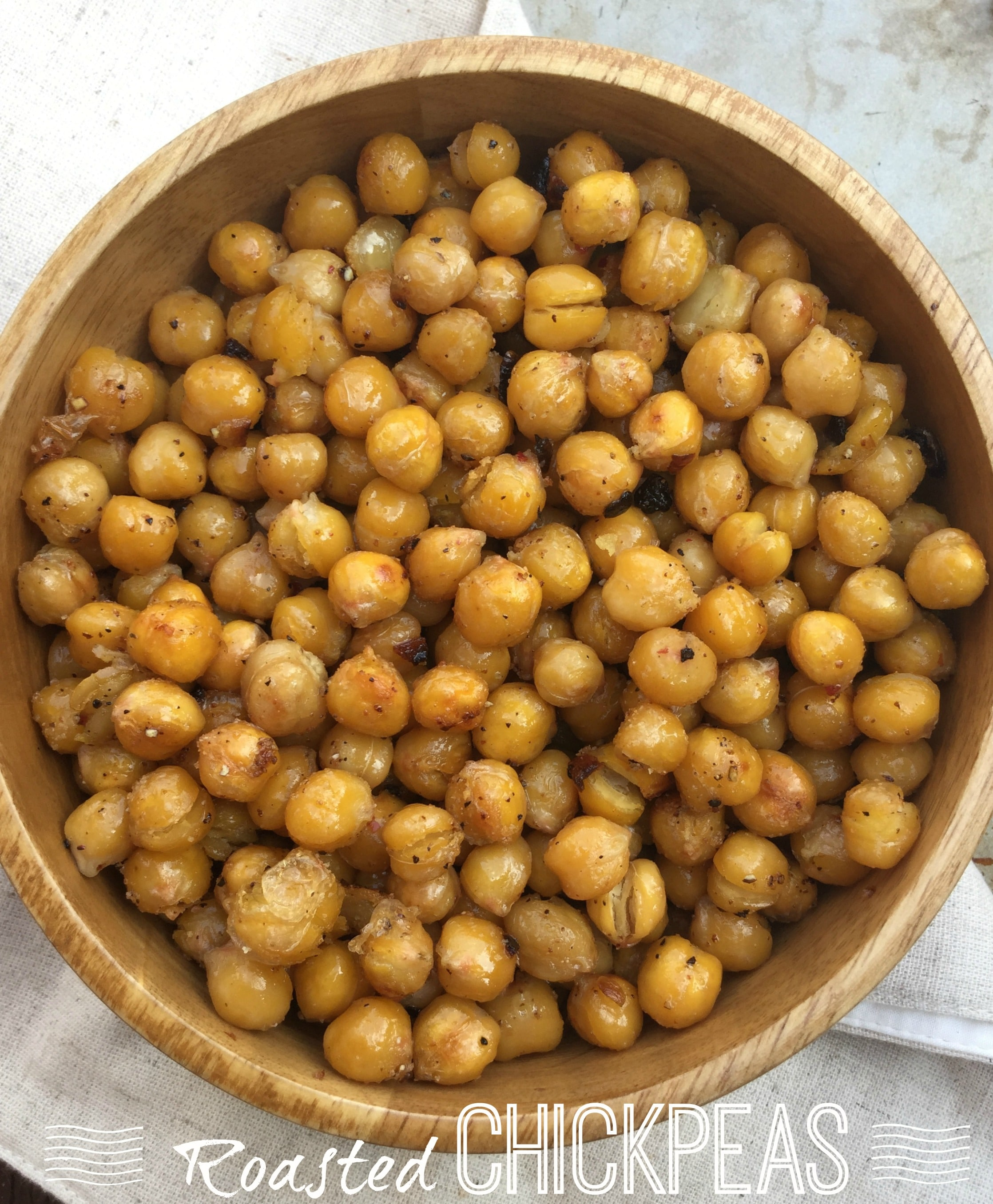 Oven roasted chickpeas deliciously flavored with garlic, chopped shallots and other spices. A great choice of healthy snack!