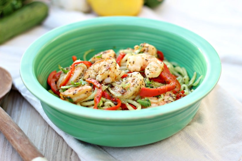 A fresh cucumber salad with shrimp sautéed in herb butter, tossed with steamed sweet red pepper and chia vinaigrette dressing with a hint of asian flavors, makes this recipe so tasty you won't want to stop eating! gardeninthekitchen.com